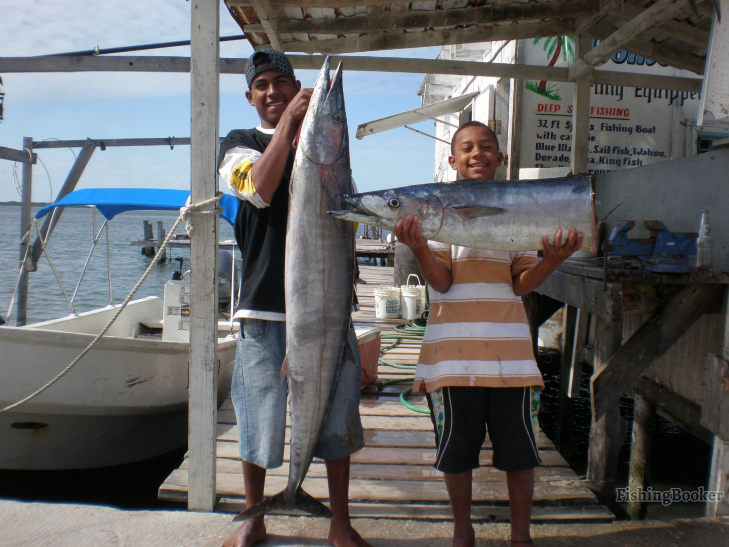 Freedom tours the reel deal ambergris caye san pedro for Deep sea fishing san pedro